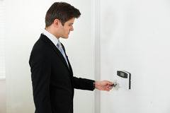 Businessman Operating Security System Stock Photos