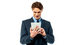 Businessman operating tablet device Stock Image