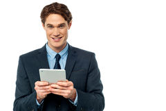 Businessman operating tablet device Stock Images