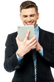 Businessman operating tablet device Royalty Free Stock Photography