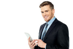 Businessman operating tablet pc Stock Photography