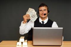 Businessman operator shows you money Stock Photos