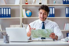 The businessman operator traveling agent working in the office Stock Images