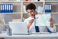 The businessman operator traveling agent working in the office Stock Photos
