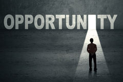 Businessman at opportunity door. Businessman standing in front of opportunity door Stock Image