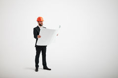 Businessman in orange hardhat looking at blueprint Royalty Free Stock Photography