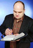 Businessman with organizer Stock Photography