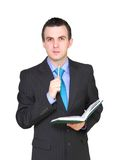 Businessman with organizer and pen. Isolated Royalty Free Stock Photography