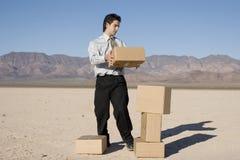 Businessman organizing boxes Stock Image