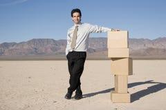 Businessman organizing boxes Royalty Free Stock Photos