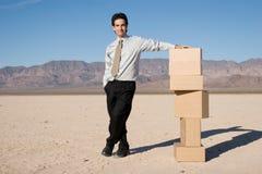 Businessman organizing boxes Stock Photo