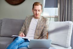 Home office staff. Businessman organizing work or analyzing online data in home office Royalty Free Stock Photography