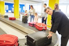 Businessman and other passengers bring their luggage stock images