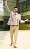 Businessman outdoor celebrating success royalty free stock photography