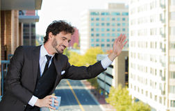Businessman outdoors, apartment balcony Royalty Free Stock Image