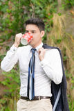 Businessman outdoors on a coffee break Stock Image