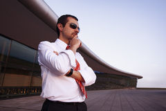 Businessman outdoors contemplating. Royalty Free Stock Photos