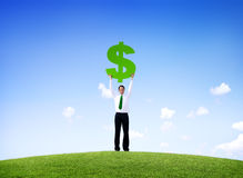 Businessman Outdoors Holding a Dollar Sign Royalty Free Stock Photos