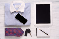 Businessman outfit and everyday objects on white wooden backgrou Stock Photography