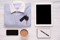 Businessman outfit and everyday objects on white wooden backgrou Royalty Free Stock Images