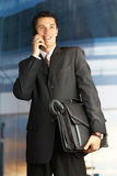 Businessman outside a modern building royalty free stock photography
