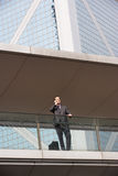 Businessman Outside Office On Mobile Phone Royalty Free Stock Images
