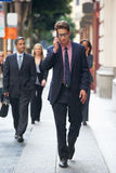Businessman Outside Office On Mobile Phone Stock Photo