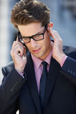 Businessman Outside Office On Mobile Phone Royalty Free Stock Image