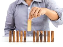 Businessman and outstanding wooden toy block Stock Images