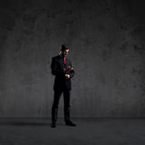 Businessman over black background. Business and office concept. Royalty Free Stock Images