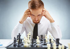 Businessman over chessboard Royalty Free Stock Photos