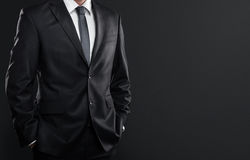 Businessman over dark background Royalty Free Stock Images