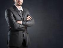 Businessman over dark background Stock Images