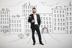 Businessman over drawing city Stock Photo