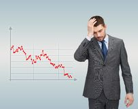 Businessman over forex graph going down Stock Photo