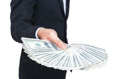 Businessman with over money on hand. Royalty Free Stock Photo