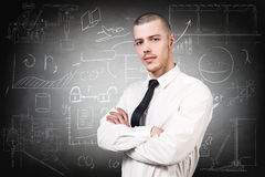 Businessman over school chalk board background. Young handsome man over school chalk board background Royalty Free Stock Image