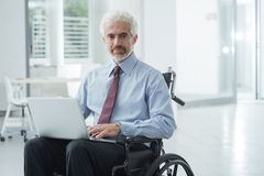 Businessman overcoming disability Royalty Free Stock Photo