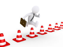 Businessman overcoming problems. 3d businessman is jumping over traffic cones Stock Photos
