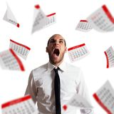 Businessman stressed and overworked screaming in office with flying paper sheets. Businessman overloaded by work in a panic royalty free stock image