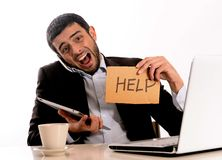 Businessman overworked at office Royalty Free Stock Photography