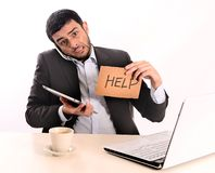 Businessman overworked at office. Business man overworked with computer, tablet and phone Royalty Free Stock Photos