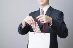 Businessman with package full of money in the hands of Royalty Free Stock Images