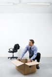 Businessman packing with carbdoard box Stock Photography