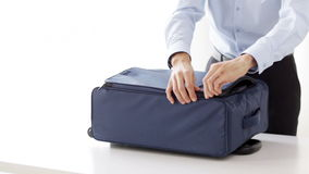 Businessman packing clothes into travel bag stock video