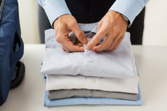 Businessman packing clothes into travel bag Royalty Free Stock Photos