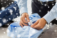 Businessman packing clothes into travel bag Stock Images