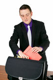 Businessman packing his briefcase Stock Photography