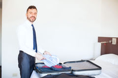 Businessman packing his clothes before leaving royalty free stock photography