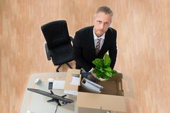 Businessman Packing Personal Things In Box royalty free stock photo